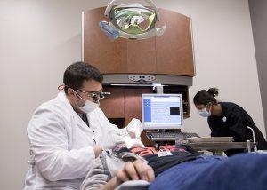 Dentist examining a patient.